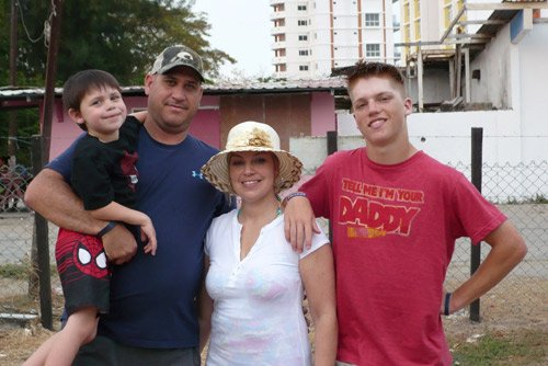 Deanna with her husband and sons on vacation in Panama